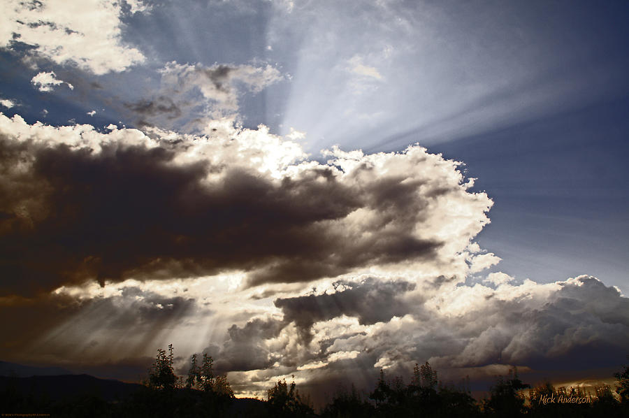 Sunlight Photograph - Sunlight And Stormy Skies by Mick Anderson