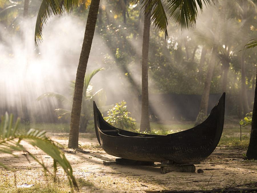 Activity Photograph - Sunlight Shining On A Canoe by Keith Levit