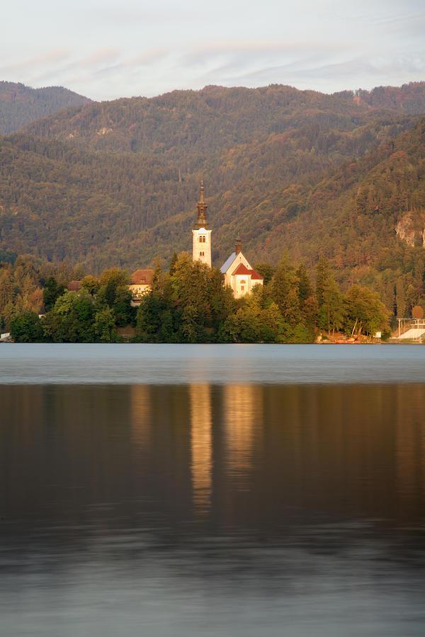 Bled Photograph - Sunrise Across Lake Bled by Ian Middleton