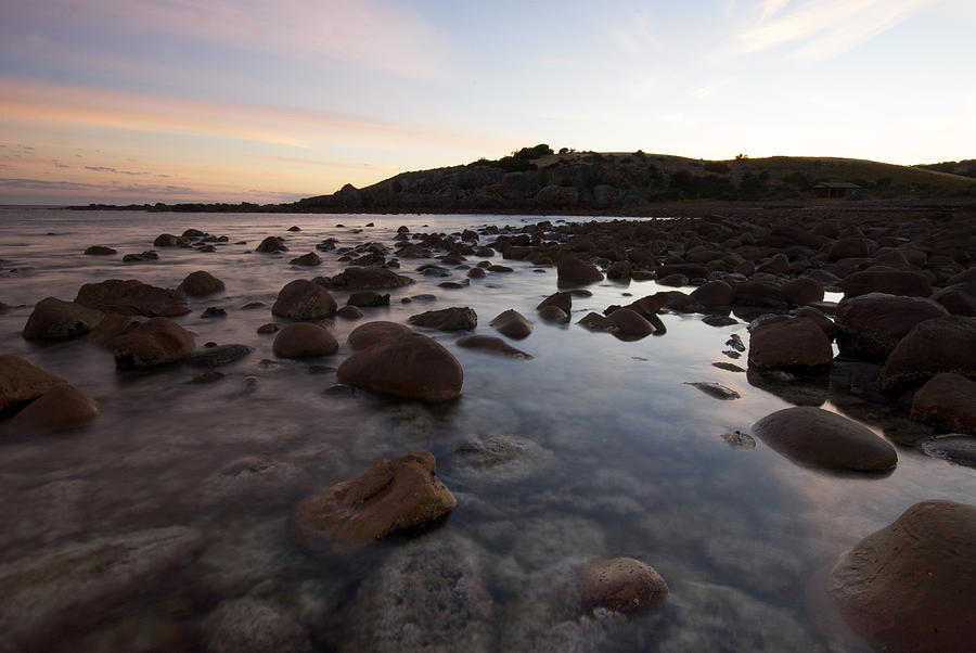 Nature Photograph - Sunrise Over A Rocky Boulder Bay by Brooke Whatnall