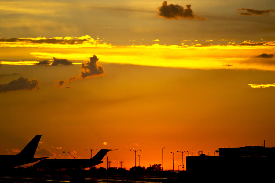Sunset Photograph - Sunset At Kci by Lisa Plymell