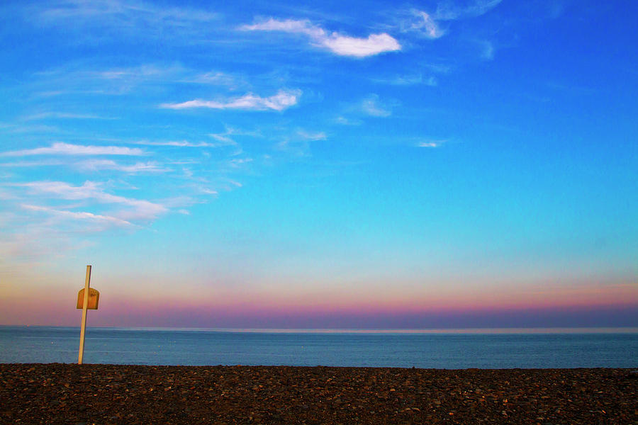 Horizontal Photograph - Sunset On Empty Beach With Lifebouy On Post by Image by Catherine MacBride