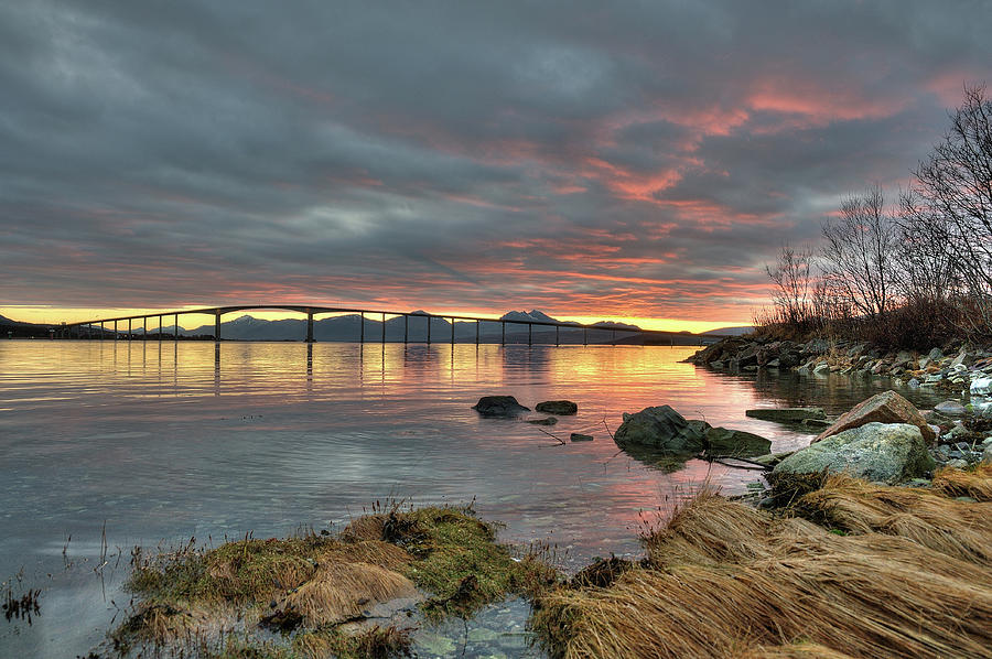 Horizontal Photograph - Sunset Reflecting Water,clouds, Sandnessund Bridge by Bernt Olsen
