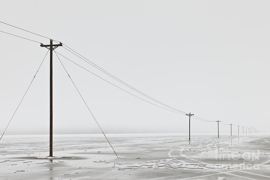 Bleak Photograph - Telephone Poles In Bleak Winter Landscape by Dave & Les Jacobs