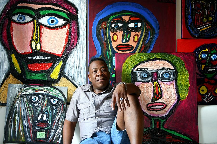 Drawing Mixed Media - The Artist Darrell Black In His Studio Sitting In Front Of His Portraits by Darrell Black