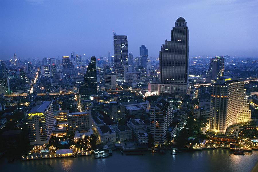 Asia Photograph - The Bangkok Skyline At Dusk by Richard Nowitz