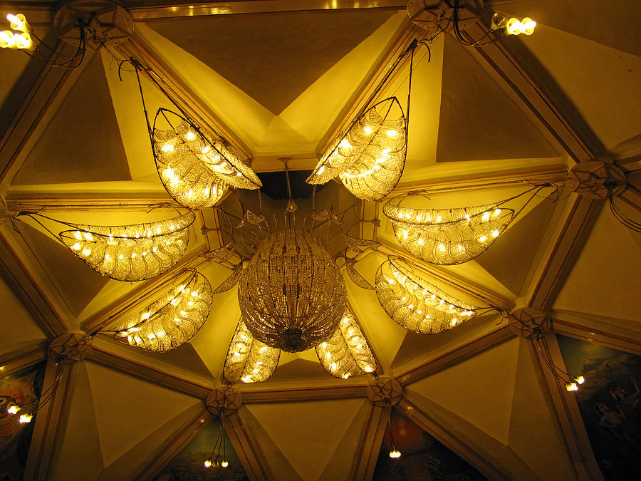 Temple Photograph - The Beautifully Lit Chandelier On The Ceiling Of The Iskcon Temple In Delhi by Ashish Agarwal