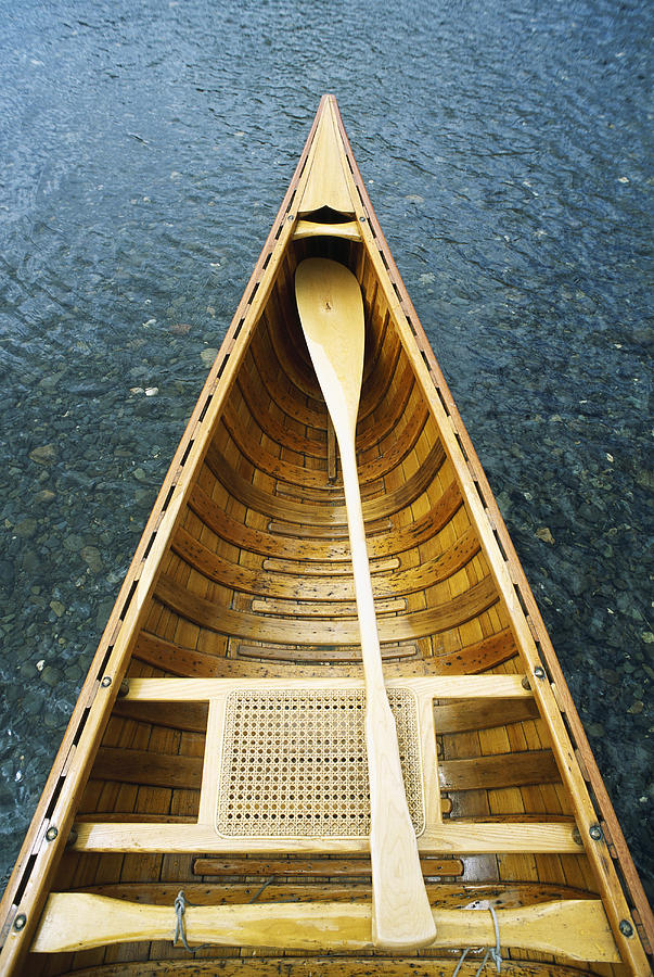 Water Photograph - The Bow And Oar Of A Handmade Wooden by Bill Curtsinger