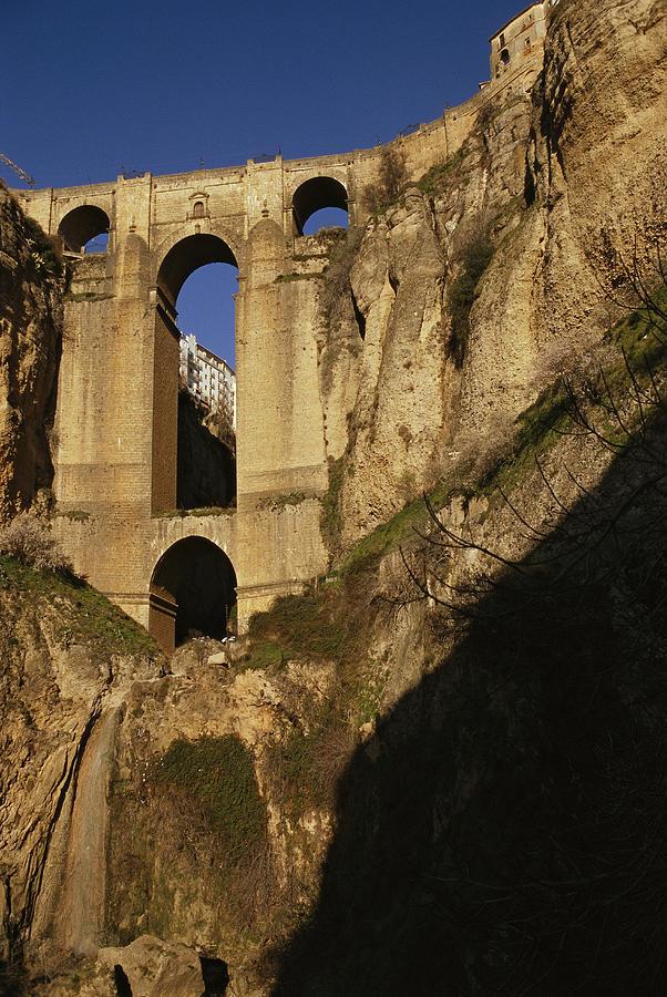 Europe Photograph - The Bridge At Ronda Spain Connects by Stephen Alvarez