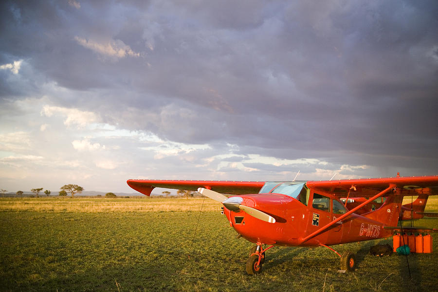 Landscape Photograph - The Cessna Makes A Pit Stop To Refuel by Michael Fay