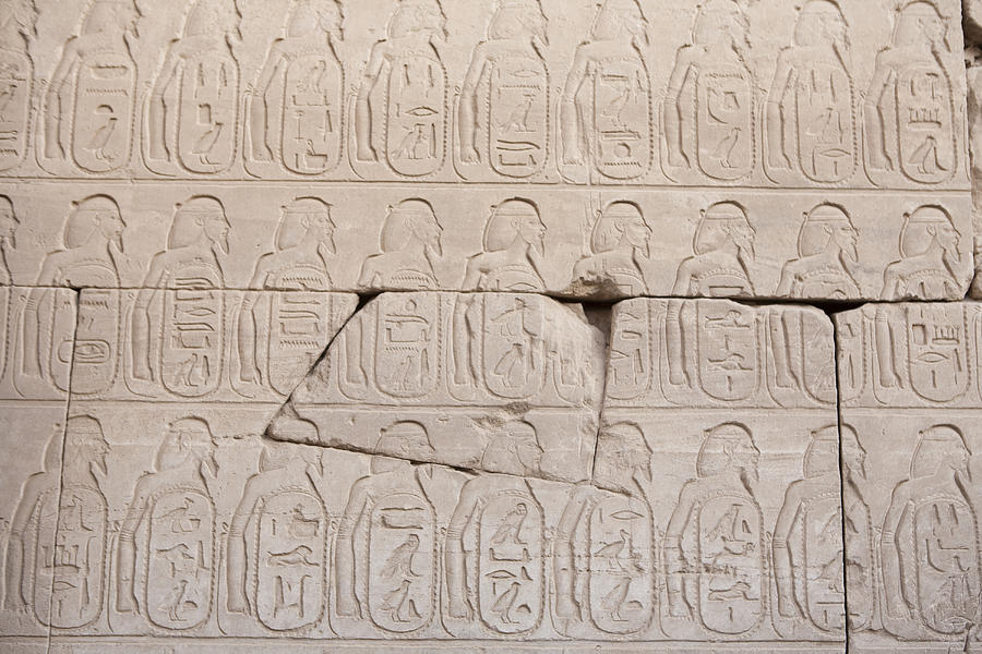Africa Photograph - The Figures Of Prisoners On A Temple by Taylor S. Kennedy