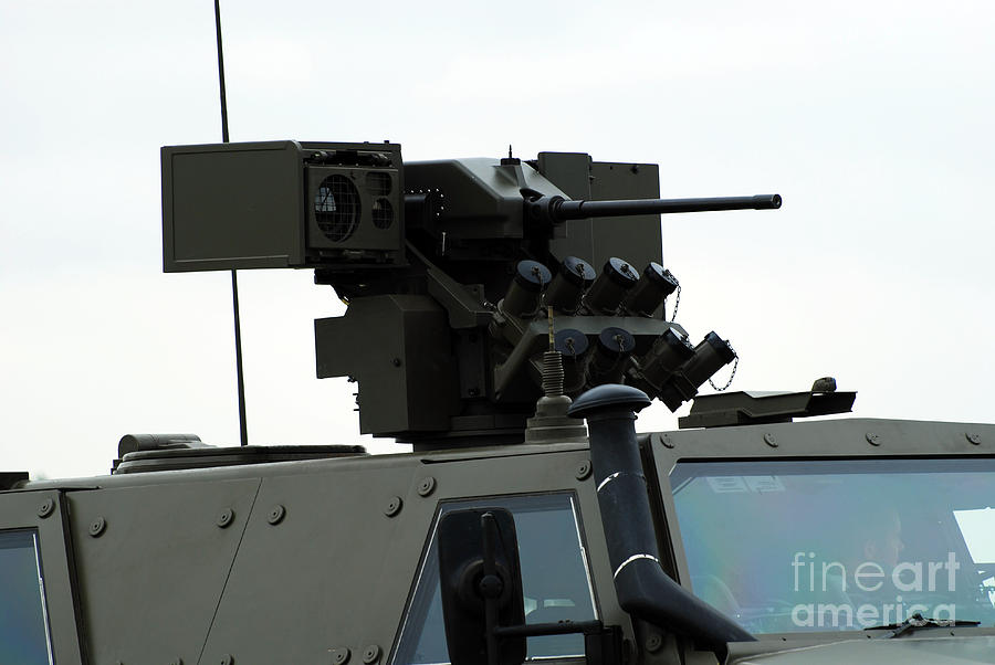 Armament Photograph - The Gun Mounted On Top Of The Dingo II by Luc De Jaeger