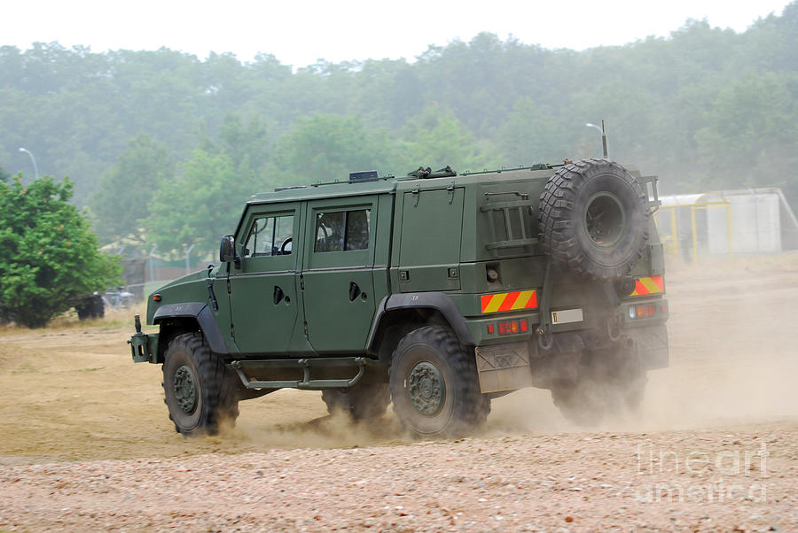 Military Photograph - The Iveco Light Multirole Vehicle by Luc De Jaeger