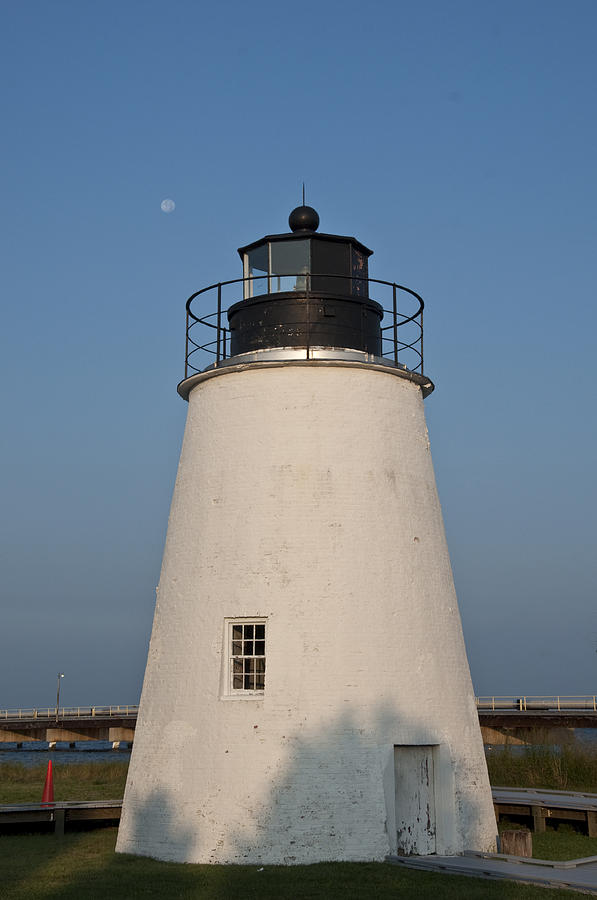 Moon Photograph - The Moon Behind The Piney Point Lighthouse by Bill Cannon
