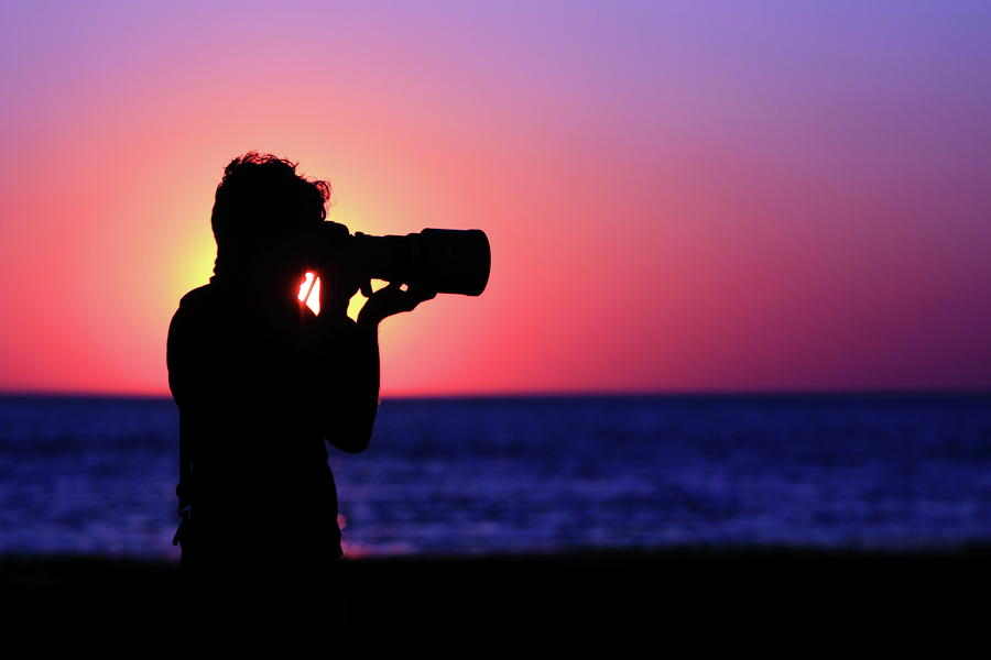 Sunset Photograph - The Photographer by Rick Berk