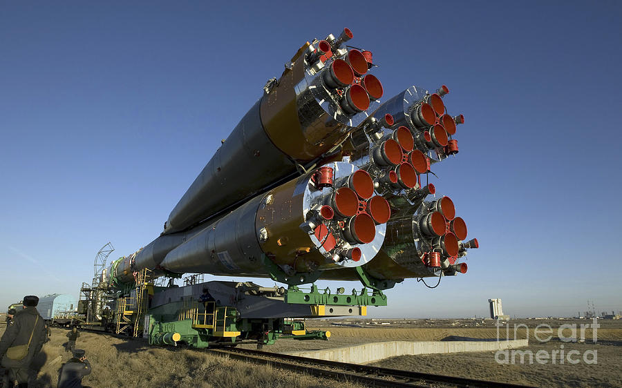 Baikonur Photograph - The Soyuz Rocket Is Rolled by Stocktrek Images