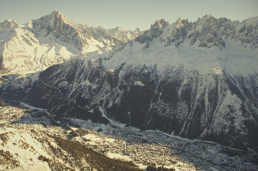 Scenes And Views Photograph - The Tourist Resort Of Chamonix Sits by Nicole Duplaix