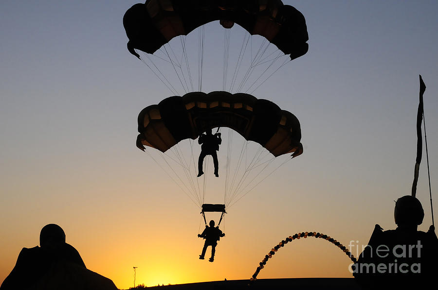 Silhouette Photograph - The U.s. Army Golden Knights Perform An by Stocktrek Images