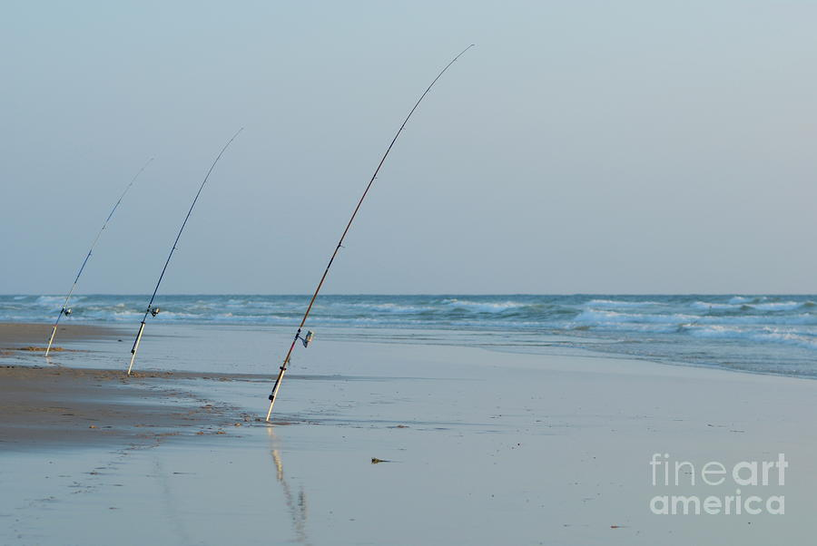 Three fishing rods on beach Photograph by Sami Sarkis