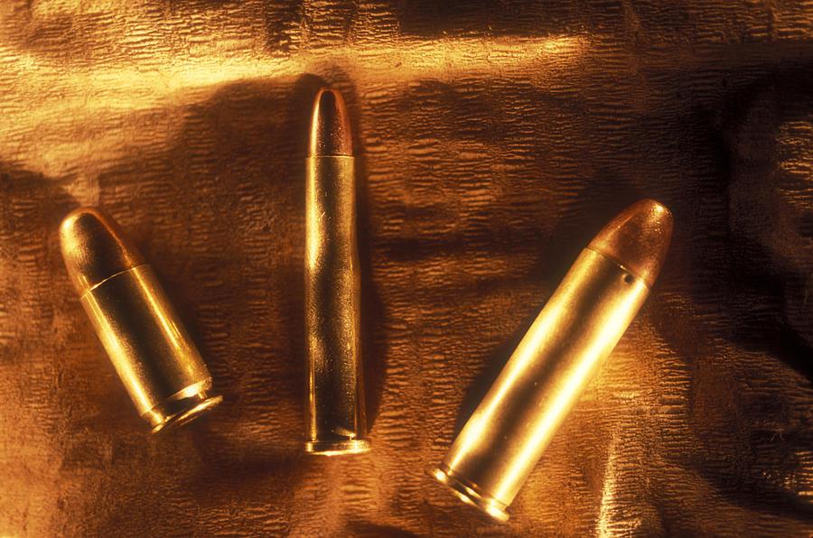 Horizontal Photograph - Three Golden 38 Calibre Bullets by Lyle Leduc