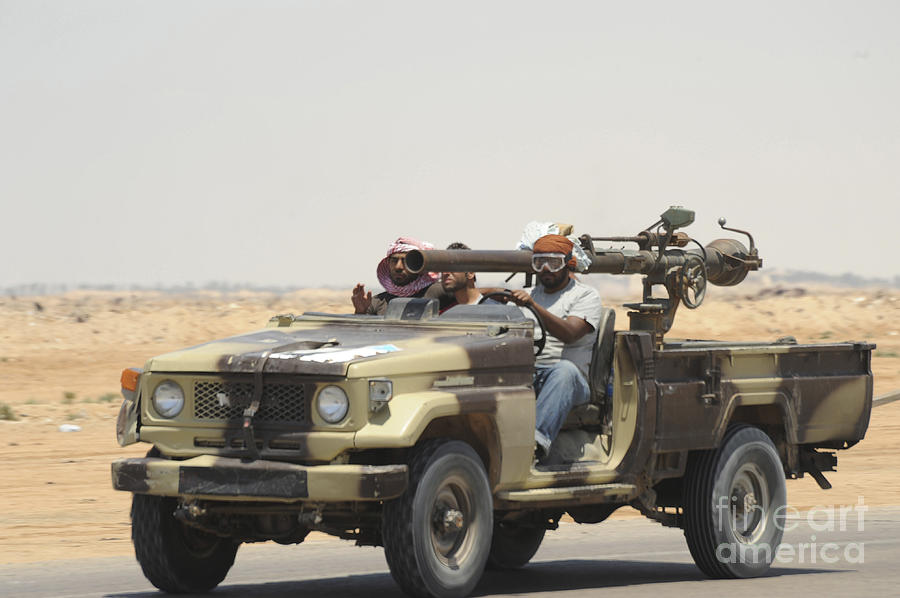 Benghazi Photograph - Three Rebel Fighters In A 4x4 by Andrew Chittock