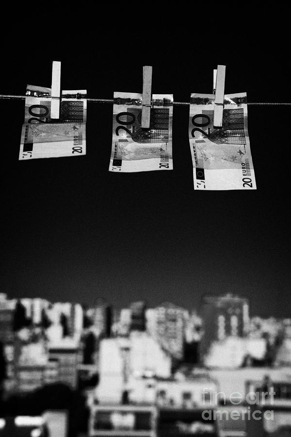 Money Photograph - Three Twenty Euro Banknotes Hanging On A Washing Line With Blue Sky Over City Skyline by Joe Fox