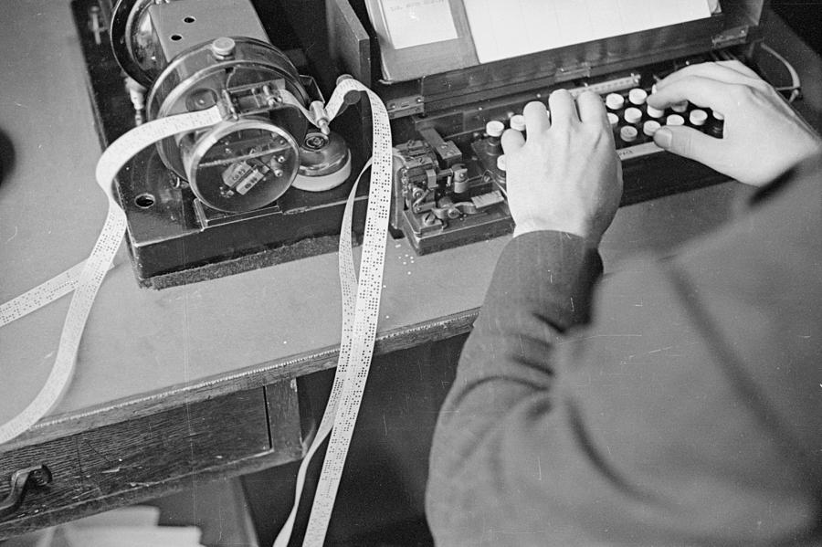 Horizontal Photograph - Ticker Tape Typing by Fox Photos