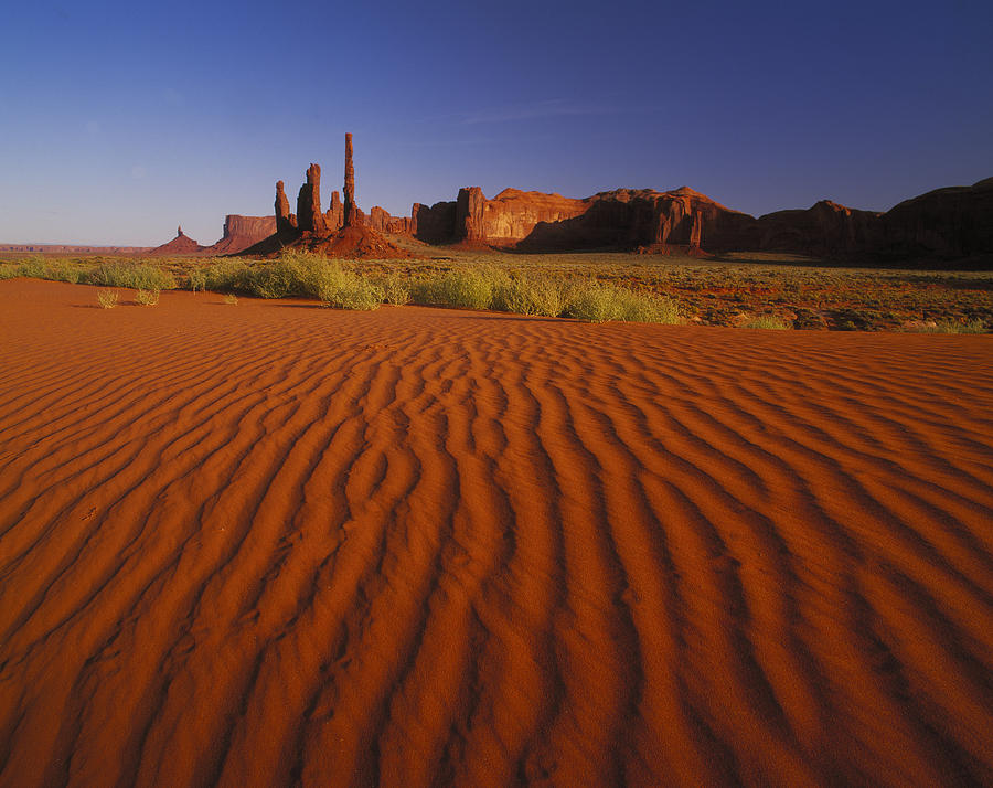 Totem Pole Rocks, Monument Valley Photograph by Brian Lawrence