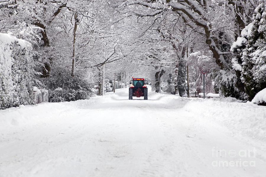 https://images.fineartamerica.com/images-medium-large/tractor-driving-down-a-snow-covered-road-richard-thomas.jpg