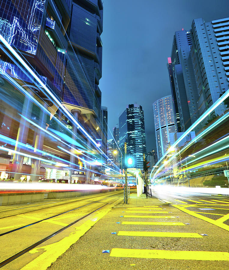 Vertical Photograph - Traffic Trails In City by Leung Cho Pan