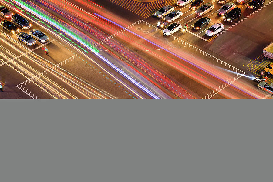 Horizontal Photograph - Traffic Trails Of Intersection by SJ. Kim