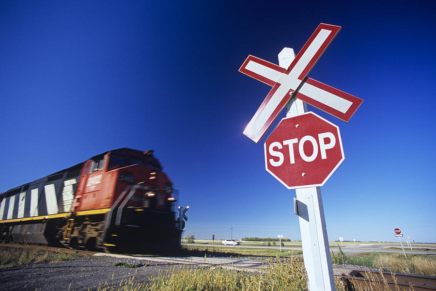 Colour Image Photograph - Train Passing Railway Crossing by Dave Reede