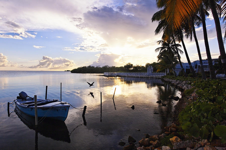 Landscape Photograph - Tranquil Sunset In A Fishing Village by George Oze