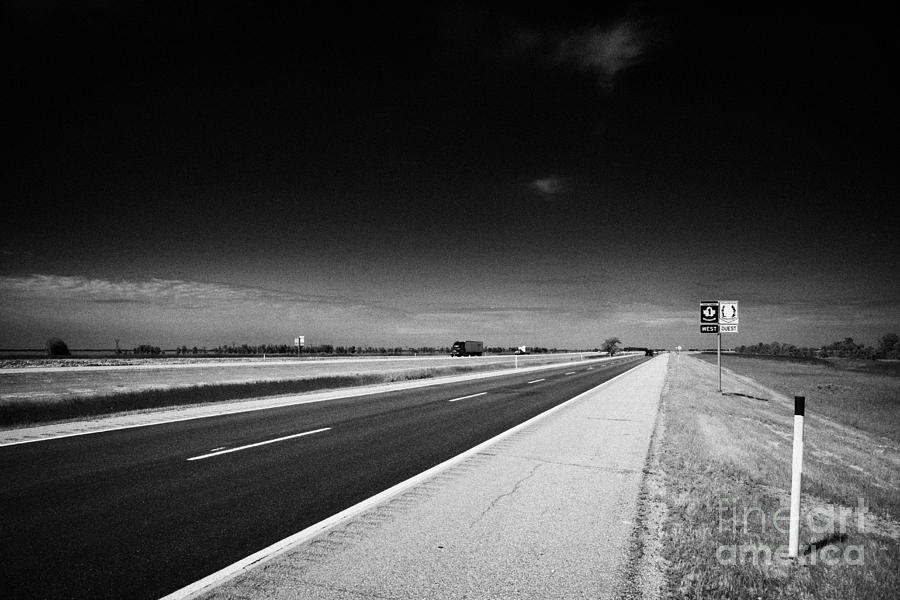 Signpost Photograph - Trans Canada Highway 1 And Yellowhead Route In Manitoba Canada by Joe Fox
