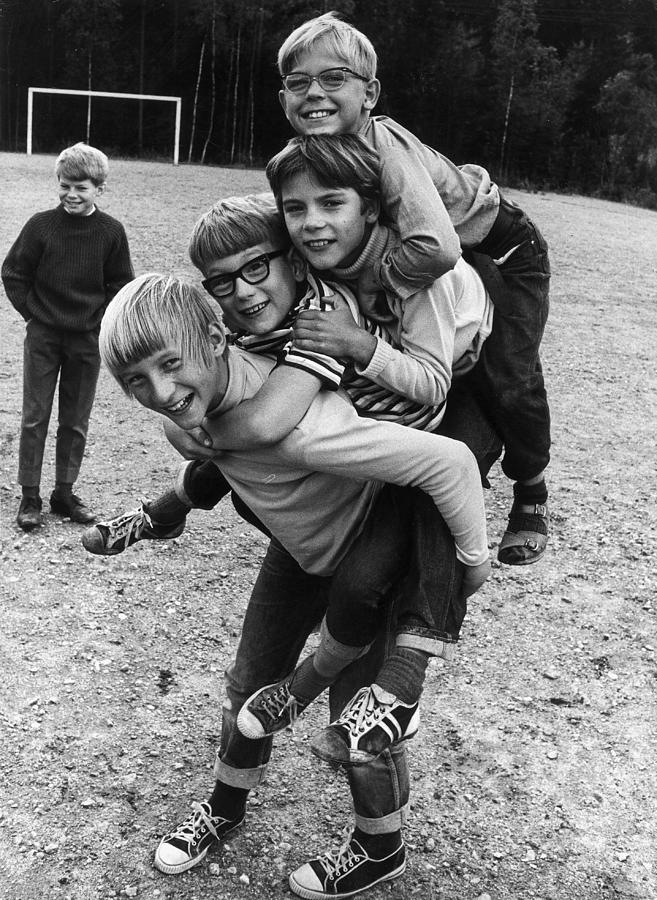 Child Photograph - Triple Piggyback Ride by Archive Photos