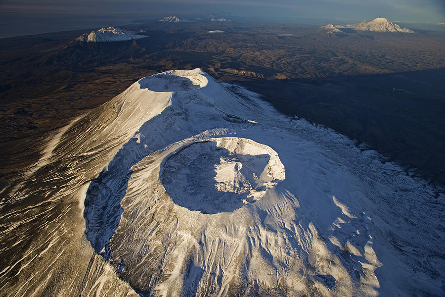 Commonwealth Of Independent States Photograph - Twin Craters Atop Krasheninnikov by Michael Melford