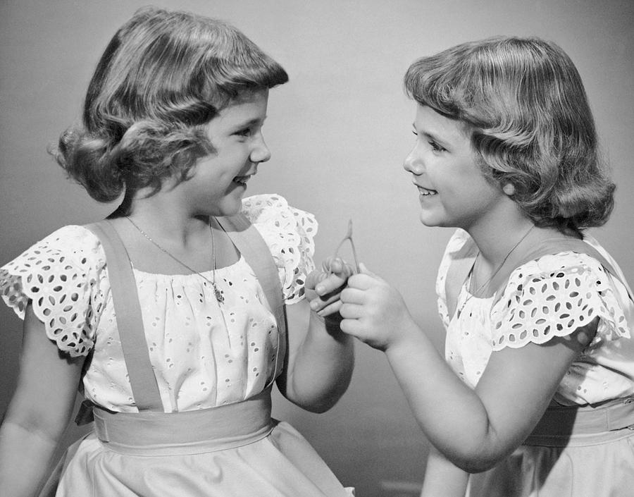 Child Photograph - Twin Sisters Making A Wish by George Marks