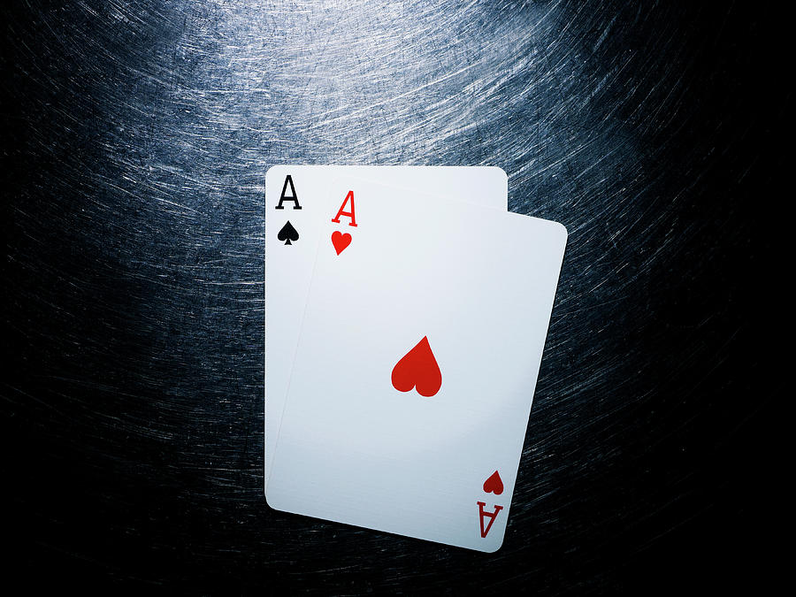 Horizontal Photograph - Two Aces Playing Cards On Stainless Steel. by Ballyscanlon