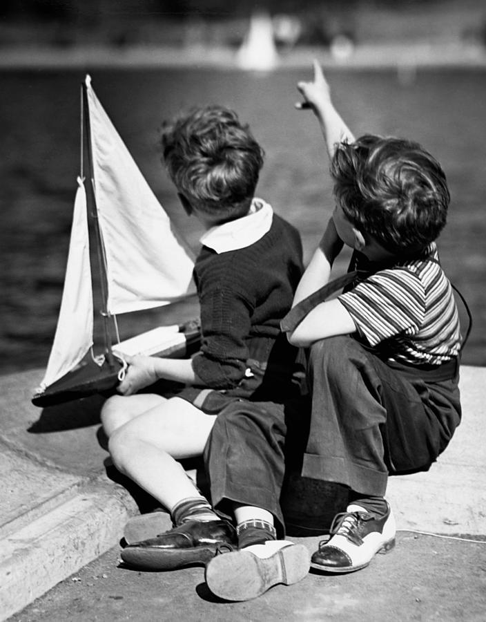 Child Photograph - Two Boys Playing W/sailboats by George Marks