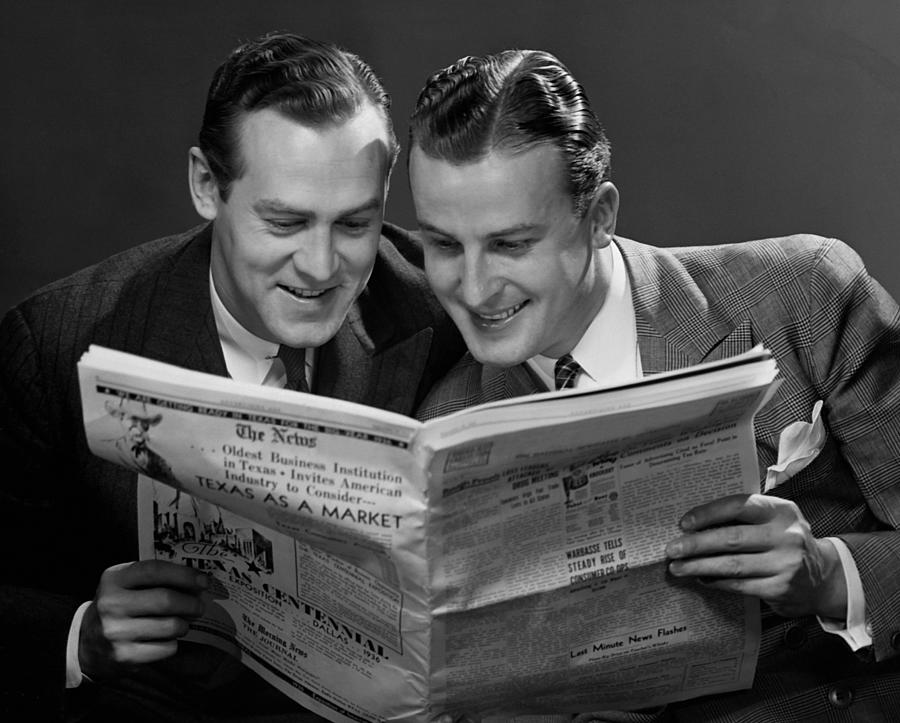 Adult Photograph - Two Businessmen Reading Newspaper by George Marks