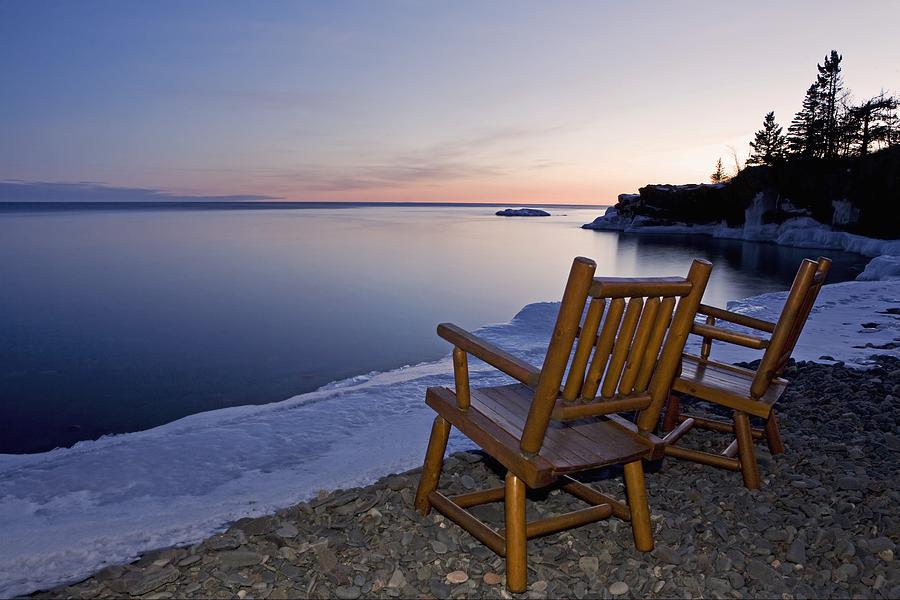 Sunset Photograph - Two Chairs At Waters Edge Looking Out by Susan Dykstra