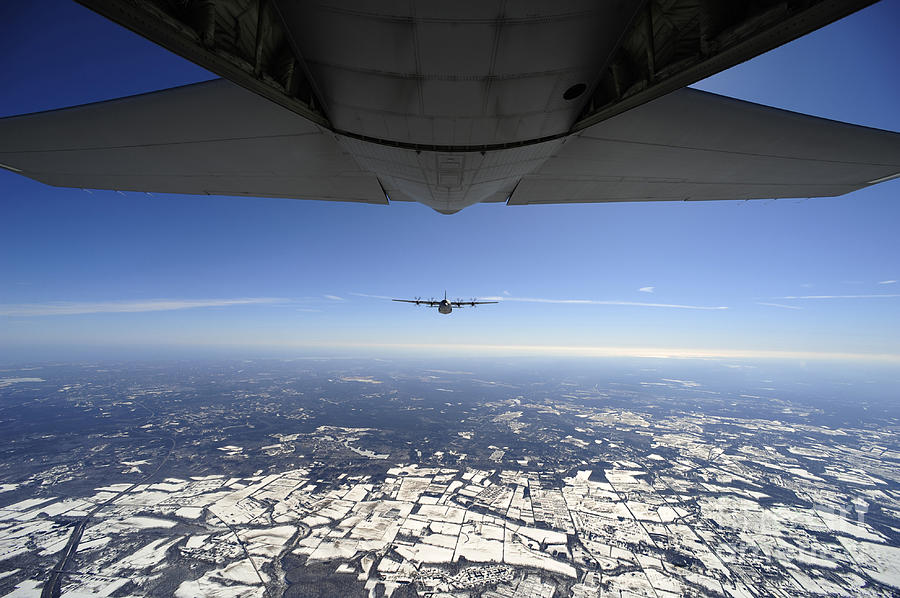Ec-130 Photograph - Two Ec-130j Commando Solo Aircraft Fly by Stocktrek Images