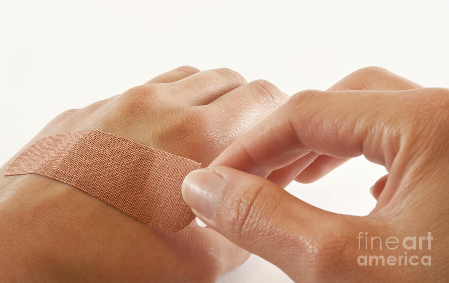 Bandage Photograph - Two Hands With Bandage by Blink Images