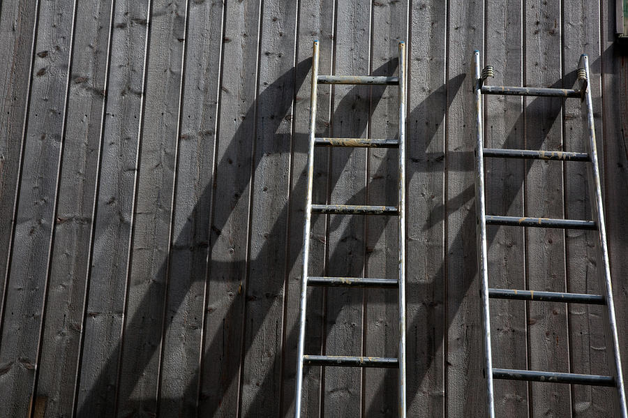 Horizontal Photograph - Two Ladders Leaning Against A Wooden Wall by Meera Lee Sethi
