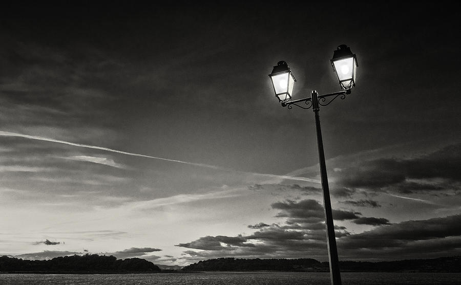 Black And White Photographs Photograph - Two Lights At The Sunset by Philippe Taka