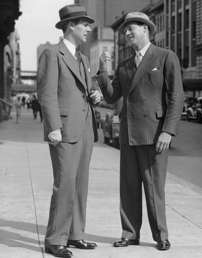 Adult Photograph - Two Men Talking On Street by George Marks