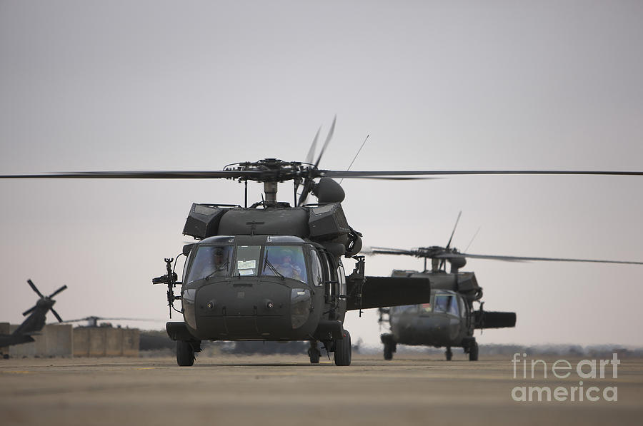 Aviation Photograph - Two Uh-60 Black Hawks Taxi by Terry Moore