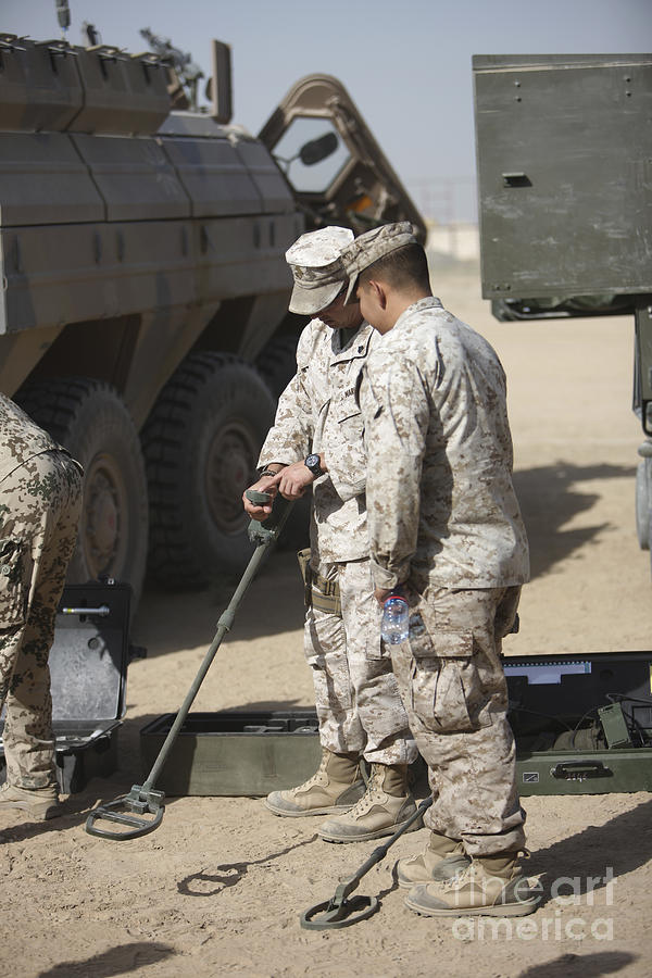 Explosive Ordnance Disposal Photograph - Two U.s. Marines Use A Mine Detector by Terry Moore