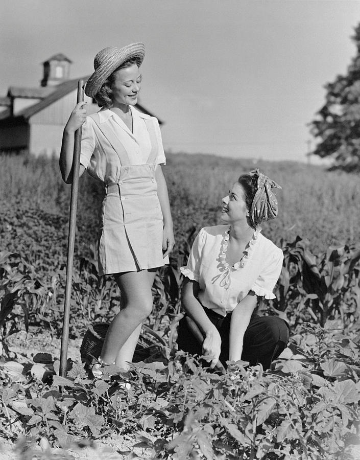 Adult Photograph - Two Women Gardening In Field by George Marks