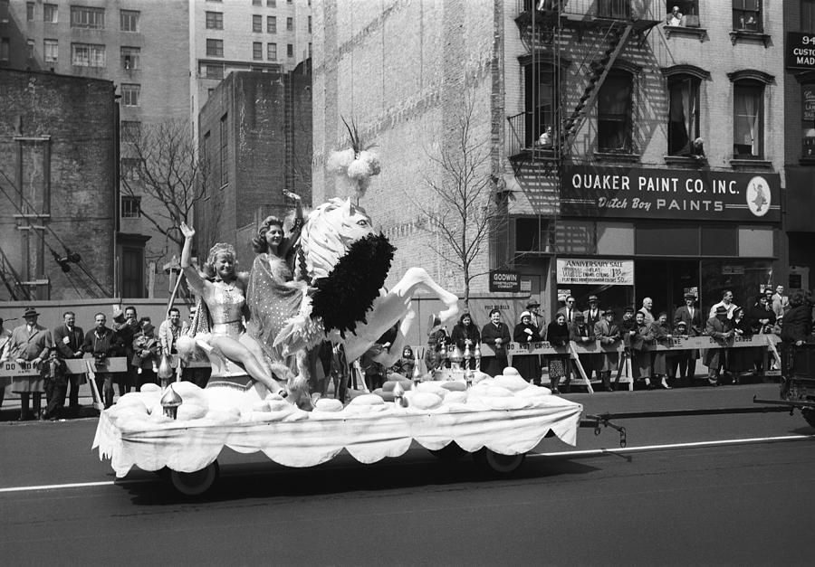 Adult Photograph - Two Women Waving From Platform During Parade by George Marks